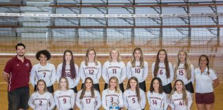 The volleyball team poses for the yearly team photo.
