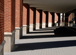 An image of the columns of the Life Sports Center, leading to the entrance to the Counseling Center.