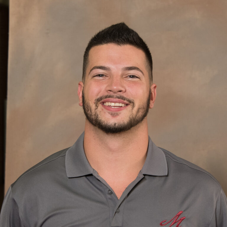 Muhlenberg Volleyball Team serves the ball to new Head Coach